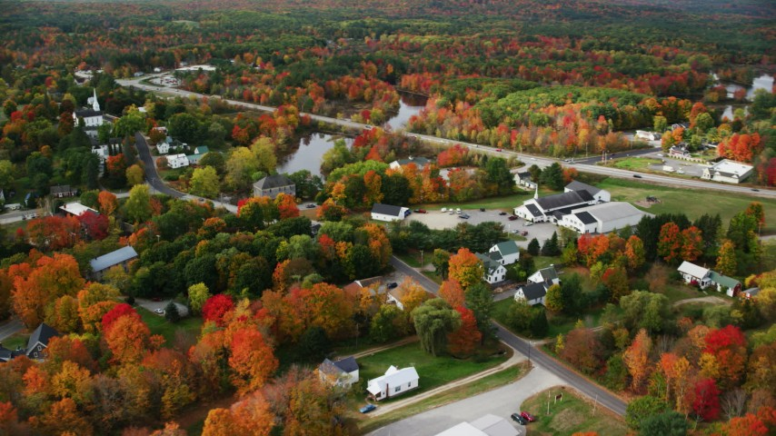 6K stock footage aerial video orbiting small rural town, colorful foliage in autumn, Turner, Maine Aerial Stock Footage | AX150_043