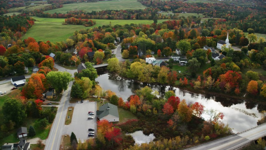 6K stock footage aerial video orbiting small rural town near Nezinscot in autumn, Turner, Maine Aerial Stock Footage | AX150_044