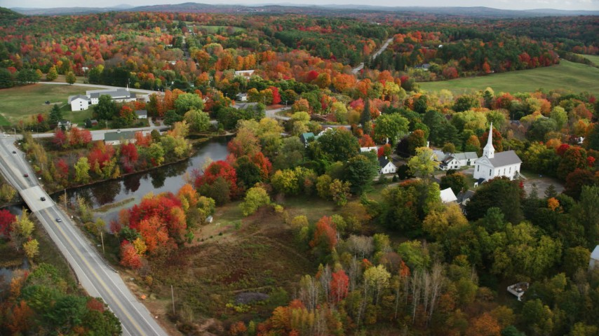 6K stock footage aerial video orbiting a small town, church, colorful foliage in autumn, Turner, Maine Aerial Stock Footage | AX150_046