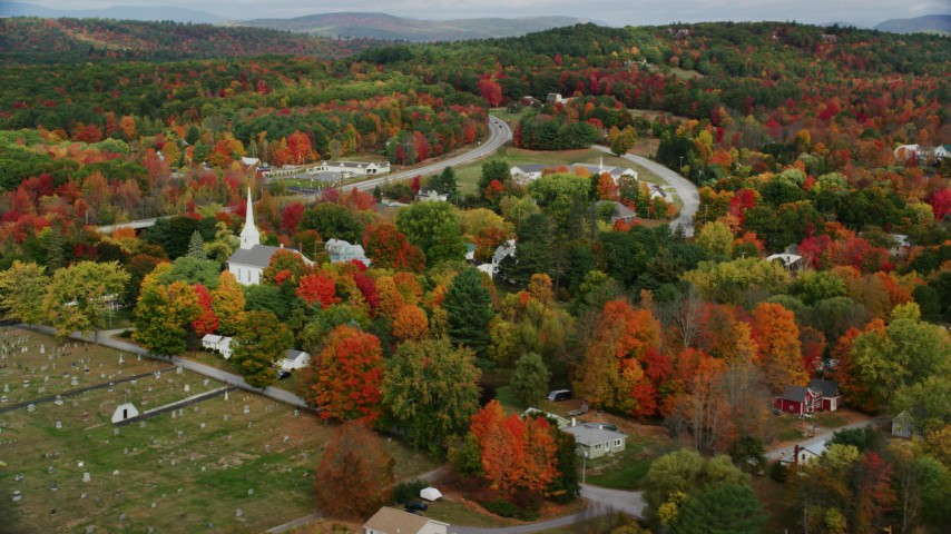 6K stock footage aerial video orbiting church in small rural town, colorful foliage in autumn, Turner, Maine Aerial Stock Footage | AX150_047