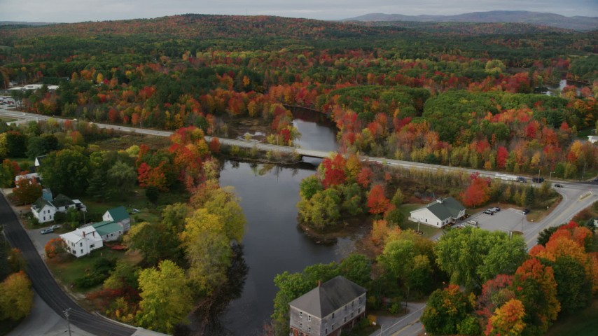 6K stock footage aerial video approaching small bridges spanning Nezinscot River, Auburn River, autumn, Turner, Maine Aerial Stock Footage | AX150_050