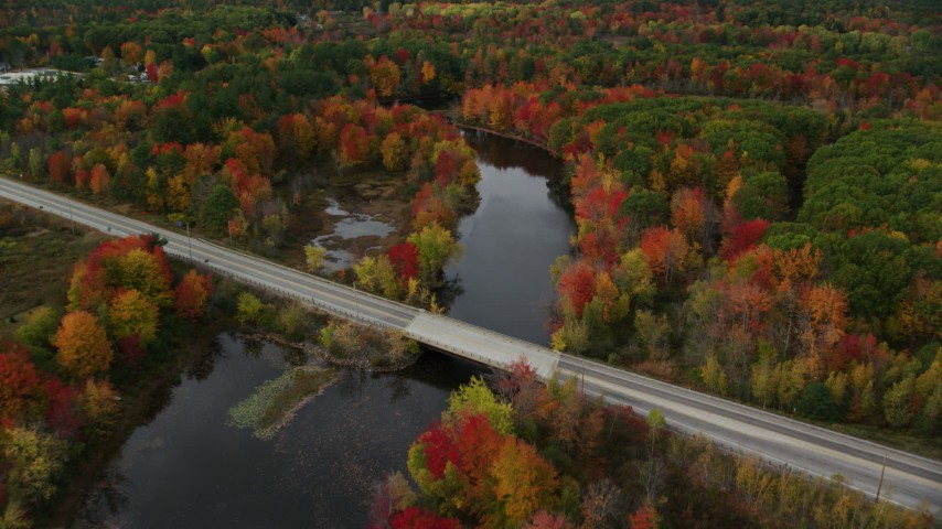 6K stock footage aerial video approaching and flying over Auburn Road, Nezinscot River, autumn, Turner, Maine Aerial Stock Footage | AX150_051