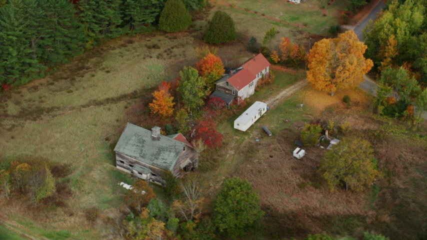 6K stock footage aerial video flying by an old barn, colorful foliage in autumn, Turner, Maine Aerial Stock Footage | AX150_053