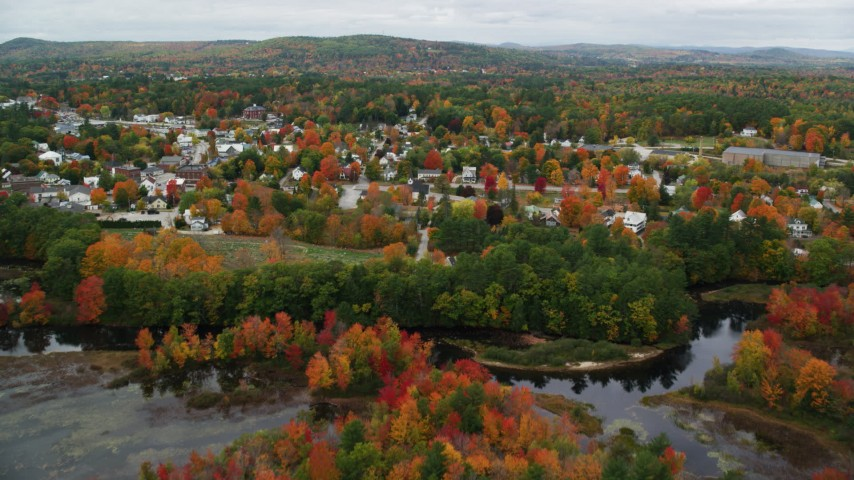 6K stock footage aerial video flying over Little Androscoggin River, approach small rural town, autumn, Paris, Maine Aerial Stock Footage | AX150_083