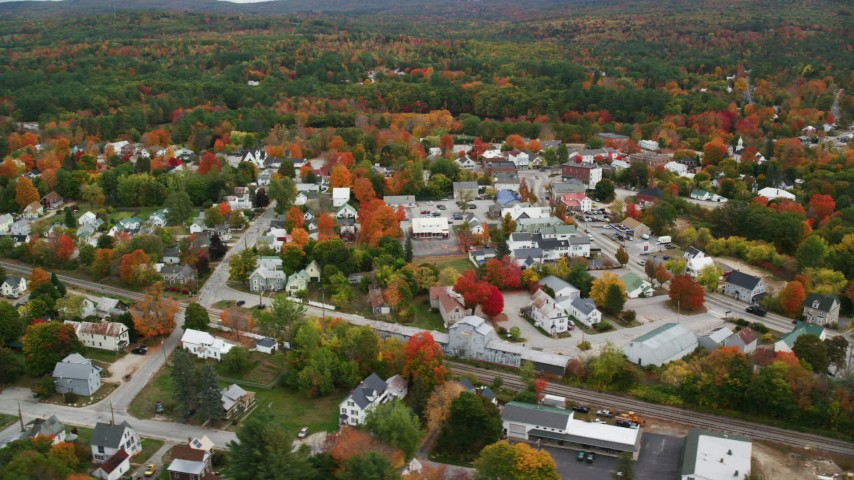 6K stock footage aerial video orbiting small rural town with colorful trees, autumn, Paris, Maine Aerial Stock Footage | AX150_086