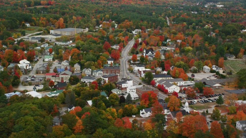 6K stock footage aerial video orbiting a small rural town, fall foliage throughout in autumn, Paris, Maine Aerial Stock Footage AX150_088