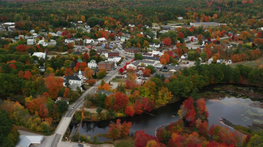 6K stock footage aerial video orbiting small rural town near the Little Androscoggin River, autumn, Paris, Maine Aerial Stock Footage | AX150_089