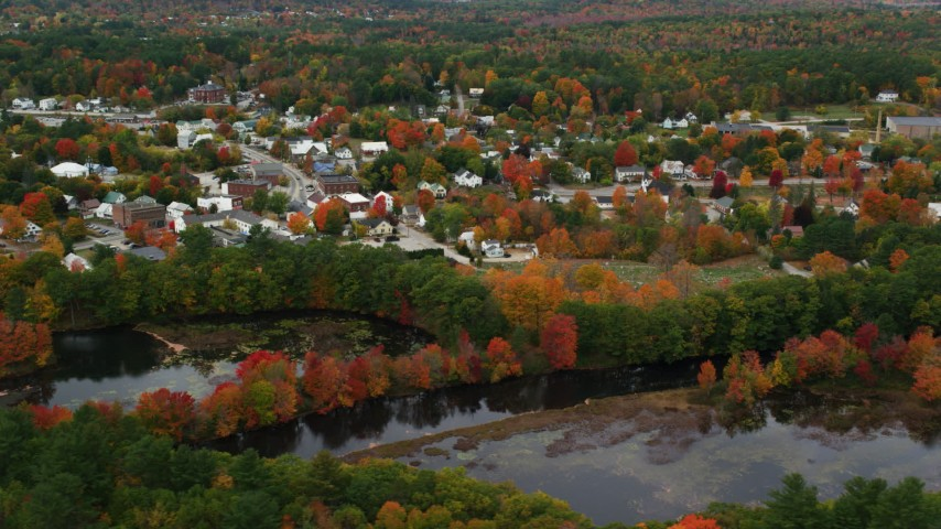 6K stock footage aerial video orbiting small rural town on the Little Androscoggin River, autumn, Paris, Maine Aerial Stock Footage | AX150_090