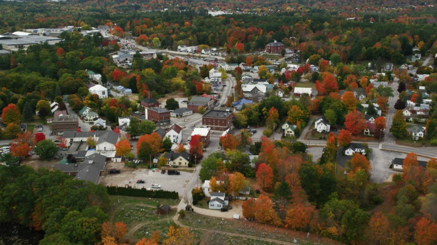 6K stock footage aerial video flying over rural homes, approaching small town in autumn, Paris, Maine Aerial Stock Footage | AX150_091