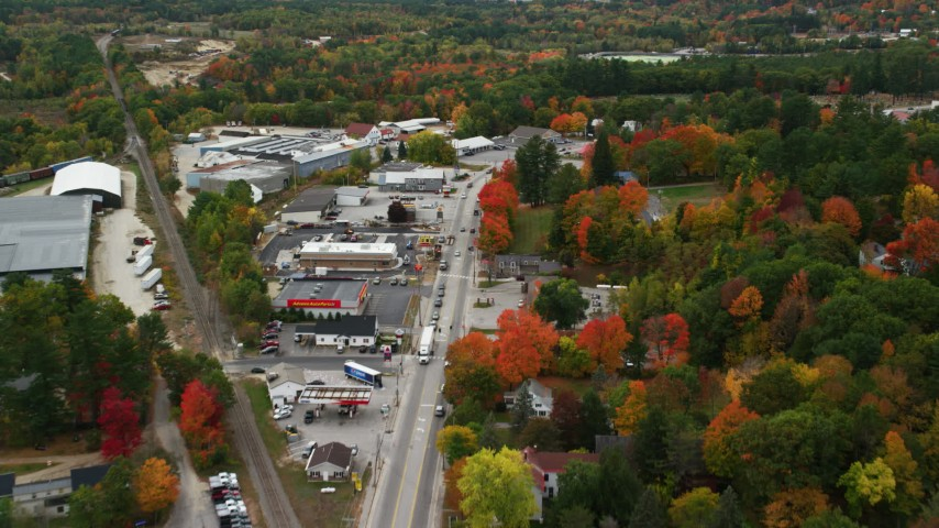 6K stock footage aerial video flying over Main Street, businesses, small town in autumn, Paris, Maine Aerial Stock Footage | AX150_093