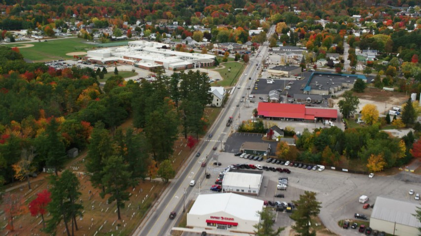 6K stock footage aerial video flying over Main Street, approach Oxford Hills Comprehensive High School, Paris, Maine Aerial Stock Footage | AX150_094