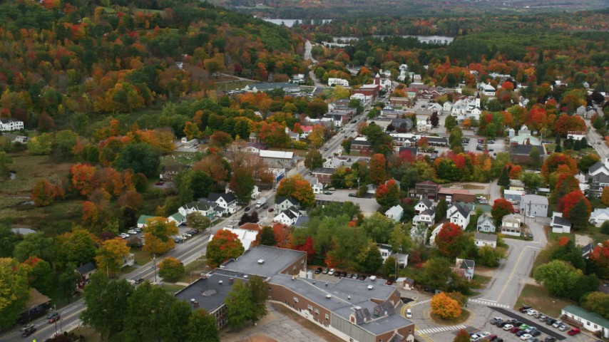 6K stock footage aerial video flying over small rural town, approaching Main Street, autumn, Norway, Maine Aerial Stock Footage | AX150_096