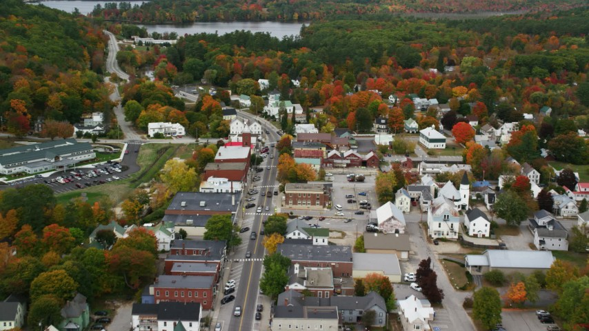 6K stock footage aerial video flying over Main Street through small rural town, tilt down, autumn, Norway, Maine Aerial Stock Footage | AX150_097