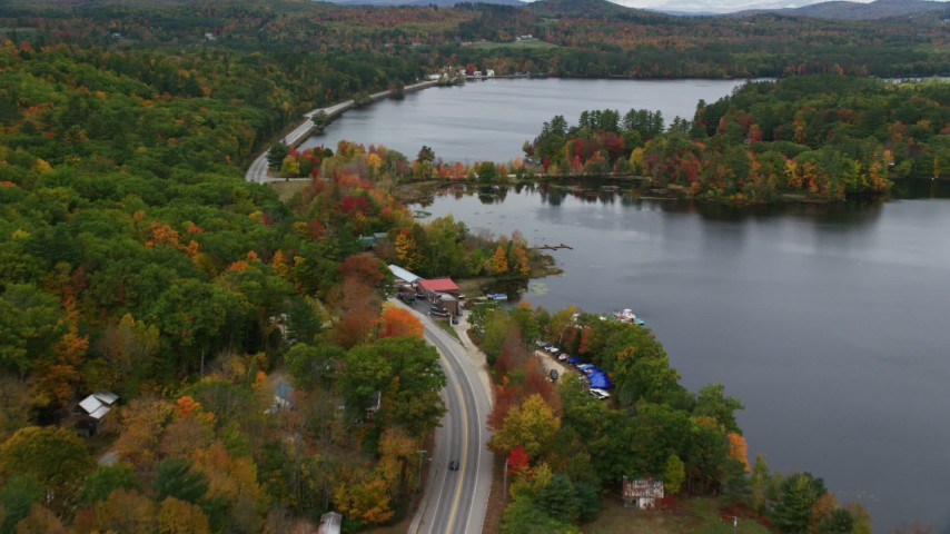 6K stock footage aerial video flying over Lake Road, Pennesseewassee Lake, autumn, Norway, Maine Aerial Stock Footage | AX150_099