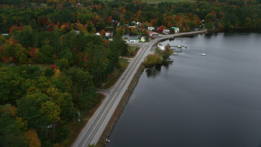 6K stock footage aerial video flying over Lake Road, Pennesseewassee Lake, reveal waterfront rural homes, autumn, Norway, Maine Aerial Stock Footage | AX150_100