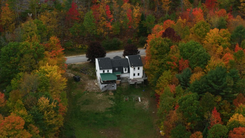 6K stock footage aerial video flying by an isolated home, colorful trees, tilt down, autumn, Norway, Maine Aerial Stock Footage | AX150_102