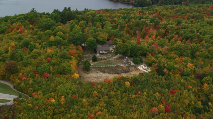 6K stock footage aerial video approaching an isolated home, tilt down, autumn, Norway, Maine Aerial Stock Footage | AX150_103