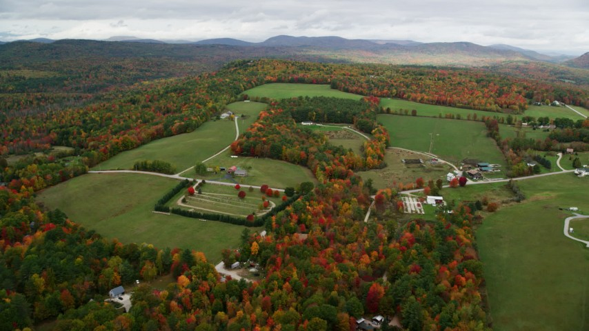 6K stock footage aerial video approaching small farms, colorful trees in autumn, pan right, Norway, Maine Aerial Stock Footage | AX150_104