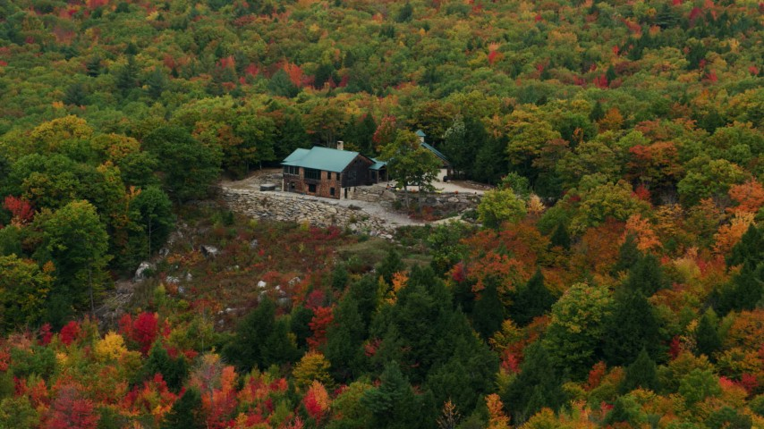 6K stock footage aerial video flying by isolated hilltop home, colorful trees in autumn, Norway, Maine Aerial Stock Footage | AX150_106