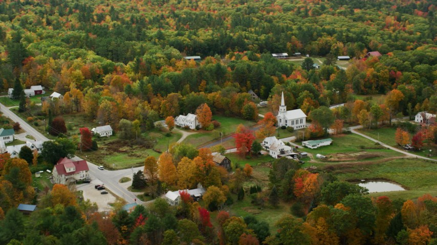 6K stock footage aerial video orbiting small rural town and church, colorful foliage, autumn, Waterford, Maine Aerial Stock Footage | AX150_118