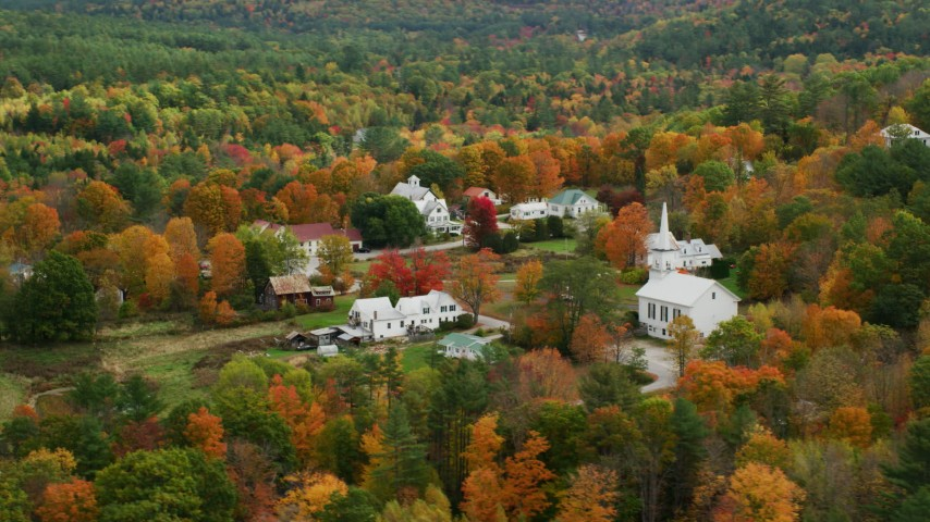 6K stock footage aerial video orbiting a small rural town, revealing a church, autumn, Waterford, Maine Aerial Stock Footage | AX150_119