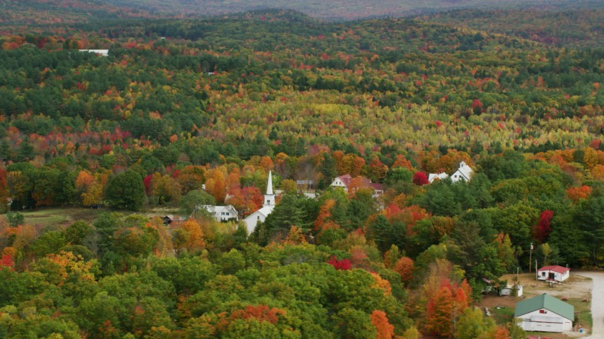6K stock footage aerial video orbiting colorful forest, small rural town, autumn, Waterford, Maine Aerial Stock Footage | AX150_120