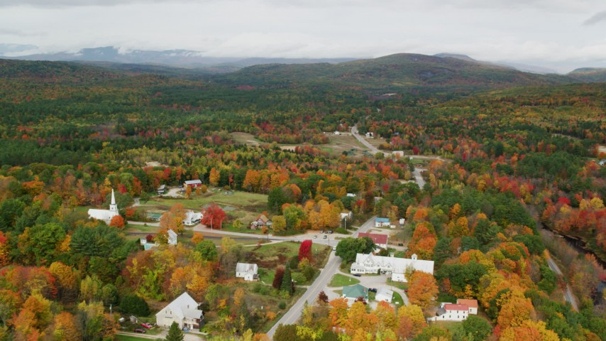 6K stock footage aerial video orbiting colorful foliage, small town, autumn, Waterford, Maine Aerial Stock Footage | AX150_122