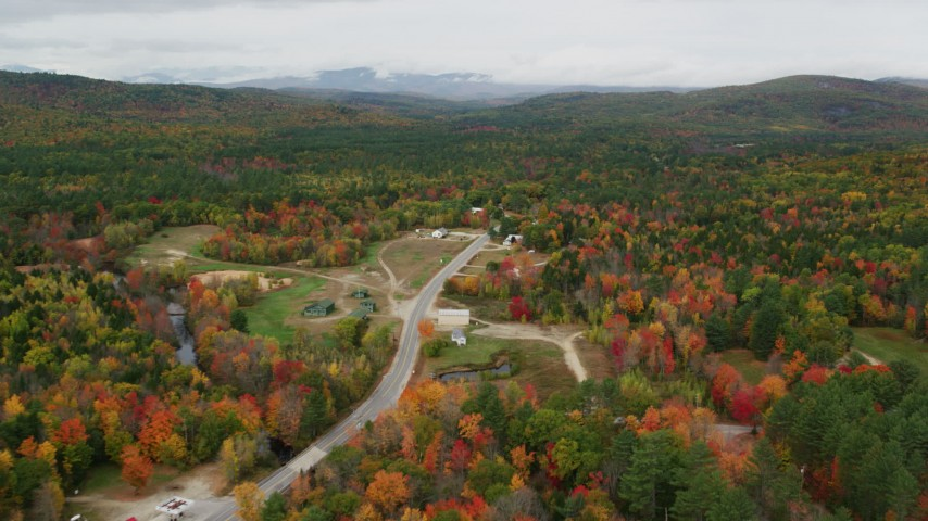 6K stock footage aerial video approaching rural homes, Valley Road, colorful forest, autumn, Waterford, Maine Aerial Stock Footage | AX150_124