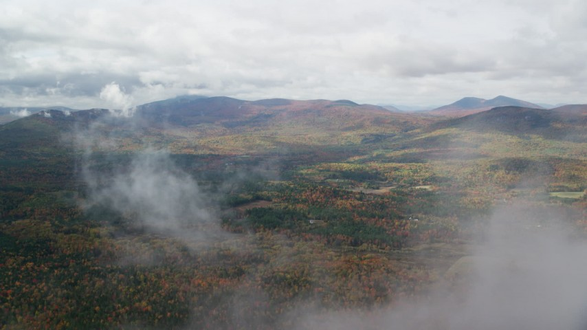 6K stock footage aerial video flying over forest, through clouds, reveal White Mountains, autumn, New Hampshire Aerial Stock Footage | AX150_147