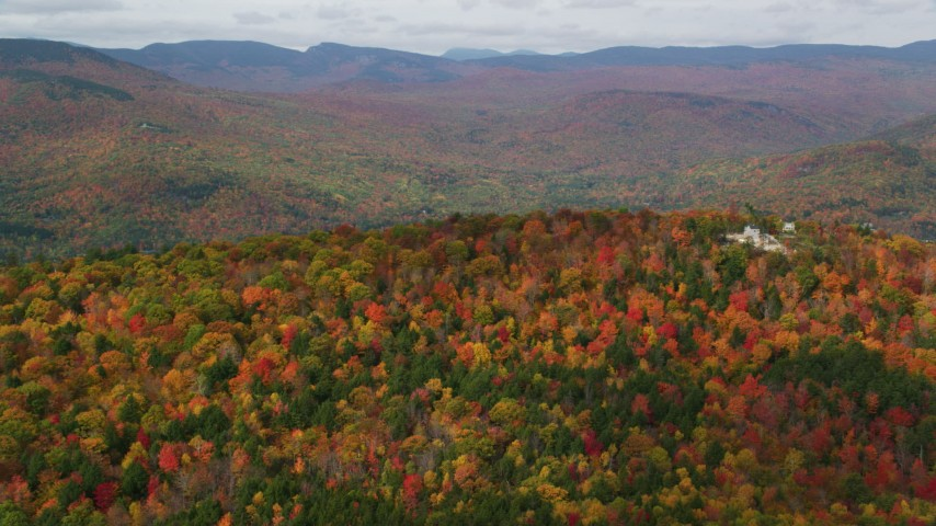 6K stock footage aerial video approaching colorful forest, White Mountains, small town of Jackson, New Hampshire Aerial Stock Footage | AX150_167
