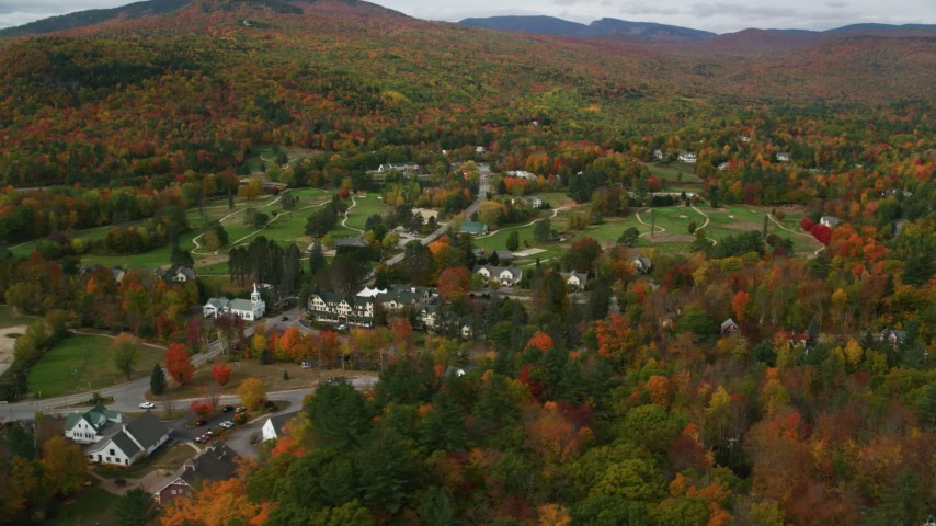 6K stock footage aerial video orbiting a small rural town, colorful trees in autumn, Jackson, New Hampshire Aerial Stock Footage | AX150_172
