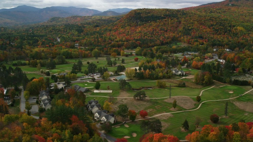 6K stock footage aerial video orbiting a small rural town, Wentworth Golf Club, autumn, Jackson, New Hampshire Aerial Stock Footage | AX150_173