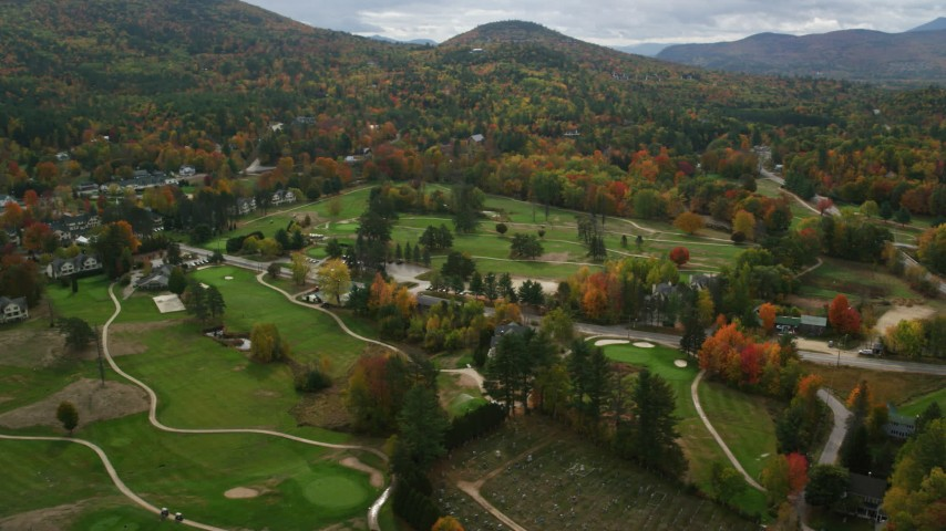 6K stock footage aerial video orbiting small rural town, Wentworth Golf Club, autumn, cloudy, Jackson, New Hampshire Aerial Stock Footage | AX150_174