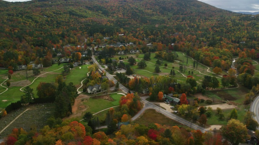 6K stock footage aerial video orbiting Wentworth Golf Club, small rural town, autumn, Jackson, New Hampshire Aerial Stock Footage | AX150_175