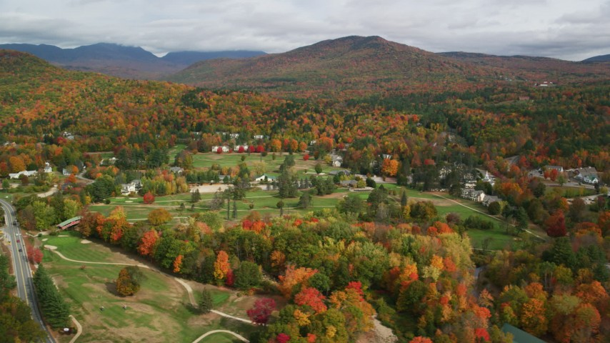 6K stock footage aerial video flying by small rural town, Wentworth Golf Club, trees, autumn, Jackson, New Hampshire Aerial Stock Footage | AX150_177