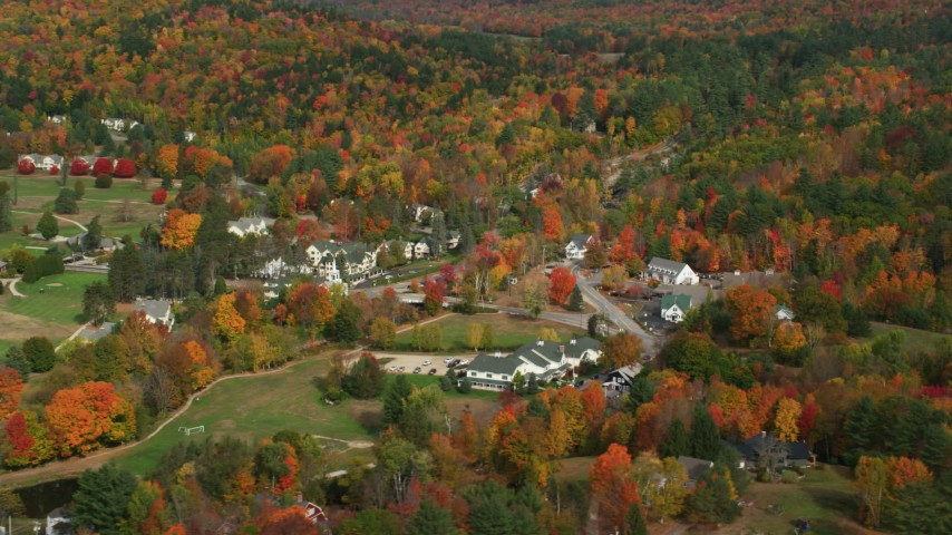 6K stock footage aerial video orbiting a small rural town, colorful foliage, autumn, Jackson, New Hampshire Aerial Stock Footage | AX150_178