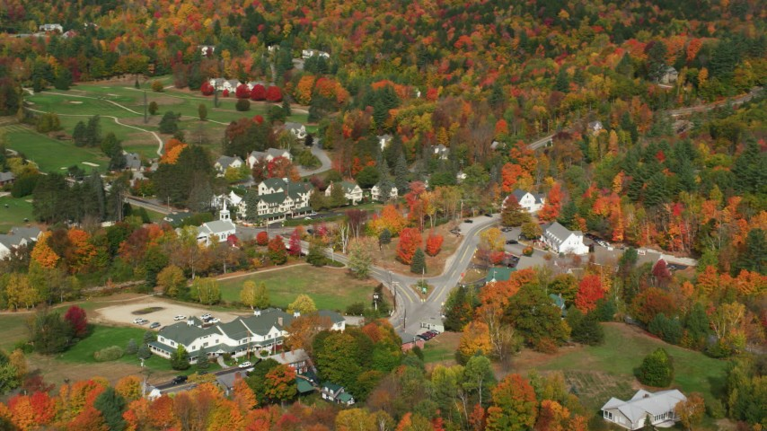 6K stock footage aerial video of a small rural town, Jackson Community Church, The Wentworth, autumn, Jackson, New Hampshire Aerial Stock Footage | AX150_179