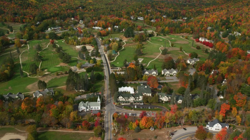 6K stock footage aerial video approaching, flying over small rural town, Wentworth Golf Club, autumn, Jackson, New Hampshire Aerial Stock Footage | AX150_180