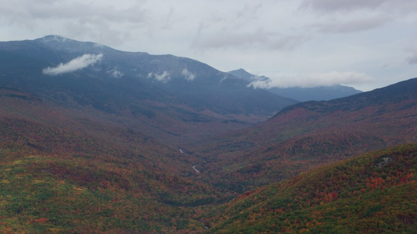 6K stock footage aerial video flying by Mount Washington, overcast, forest, autumn, White Mountains, New Hampshire Aerial Stock Footage | AX150_184