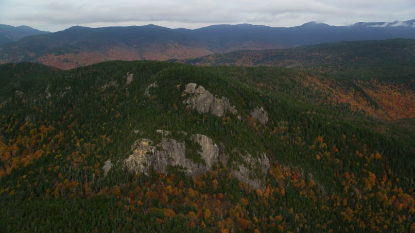 6K stock footage aerial video flying by forest, Stairs Mountain, autumn, overcast, White Mountains, New Hampshire Aerial Stock Footage | AX150_193