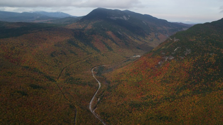 6K stock footage aerial video of Highway 302, forest, Mount Willey, autumn, rainy, White Mountains, New Hampshire Aerial Stock Footage | AX150_194