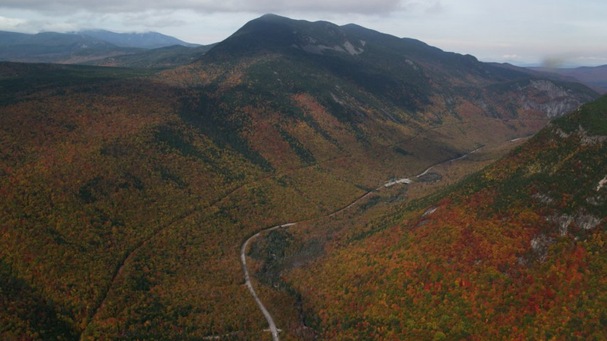 6K stock footage aerial video of Highway 302, Mount WIlley, forest, autumn, rainy, White Mountains, New Hampshire Aerial Stock Footage | AX150_195