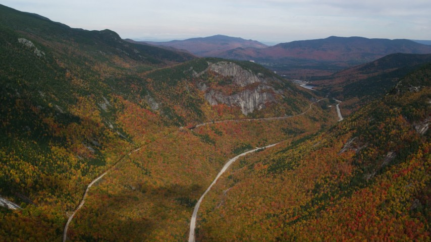 6K stock footage aerial video flying over Highway 302, colorful forest, autumn, overcast, White Mountains, New Hampshire Aerial Stock Footage | AX150_197