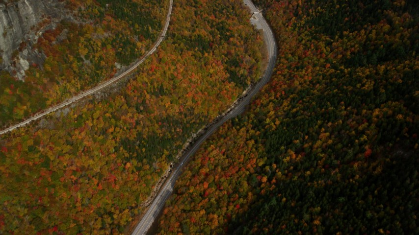 6K stock footage aerial video of a bird's eye view over Highway 302, dense, colorful trees, autumn, White Mountains, New Hampshire Aerial Stock Footage | AX150_199