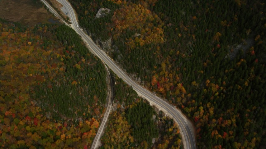 6K stock footage aerial video of a bird's eye view over Highway 302, forest, reveal pond, autumn, White Mountains, New Hampshire Aerial Stock Footage | AX150_200