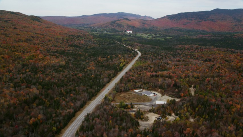 6K stock footage aerial video flying over forest, Highway 302, autumn, overcast, White Mountains, New Hampshire Aerial Stock Footage | AX150_201