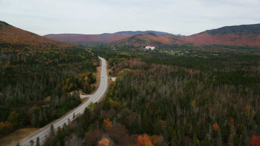 6K stock footage aerial video flying over Highway 302, forest, tilt down, autumn, White Mountains, New Hampshire Aerial Stock Footage | AX150_202