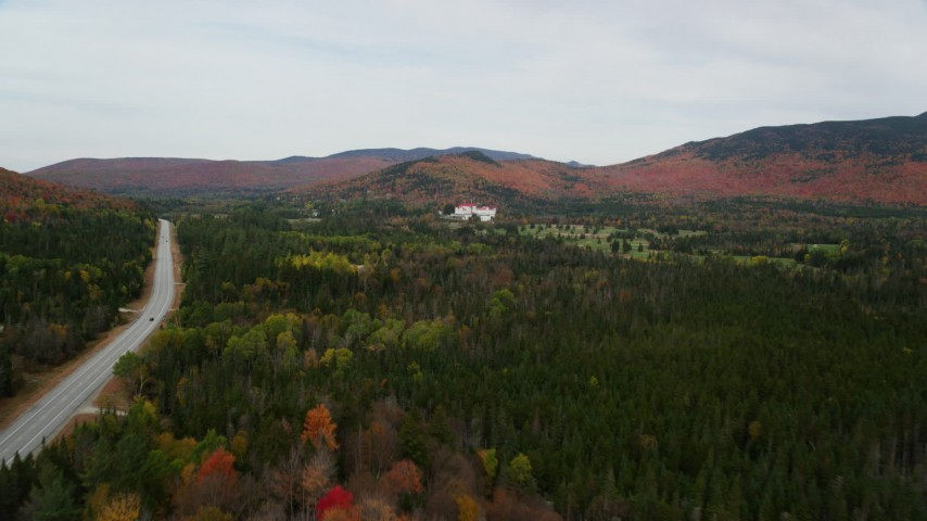 6K stock footage aerial video approaching Omni Mount Washington Resort, Bretton Woods, autumn, Carroll, New Hampshire Aerial Stock Footage | AX150_203