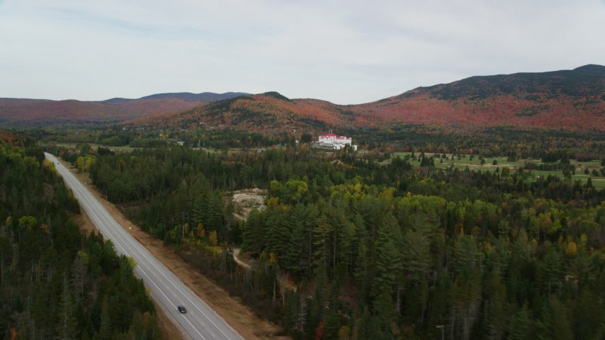 6K stock footage aerial video of Highway 302, Omni Mount Washington Resort, Bretton Woods, autumn, Carroll, New Hampshire Aerial Stock Footage | AX150_204