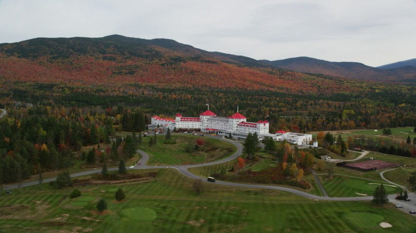 6K stock footage aerial video orbiting Omni Mount Washington Resort, Bretton Woods, autumn, Carroll, New Hampshire Aerial Stock Footage | AX150_206